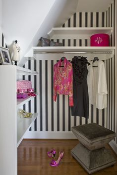 Closet featuring black and white wallcovering paper by Farrow & Ball.
