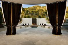 midcentury round patio with dark brown and white high drapes all over of Beautiful Drapes for Your Outdoor Areas