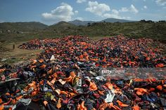 A pile of thousands of discarded life vests are dumped in a valley in hills above the town on March 27, 2016 in Mithymna, Greece. New boat arrivals on the island have reduced to almost zero over the last few days, but it remains unclear whether that is due to the windy weather or the deal between the EU and Turkey. The aid agency Doctors Without Borders, or MSF (Medecines Sans Frontieres), has recently announced that it was to cease operations in the Greek refugee camp at Moira. MSF spoke…