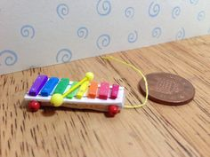 Hand made Dolls house Miniature replica vintage fisher price pull a tune xylophone 1/12 scale