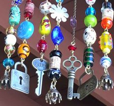Jewelry for your patio!! This wind chime is very colorful and has two lock and key sets. One says hope and the other life. It has three hammered brass flower charms and three lovely sounding bells. The beads are strung with brass wire from a piece of mesquite* that is so smooth and pretty that it almost looks fake! Its very quite so it wont disturb neighbors.  This wind chime can withstand quite a bit of wind, rain, and snow but should be cared for during extreme weather. *Mesquite wood is 2…