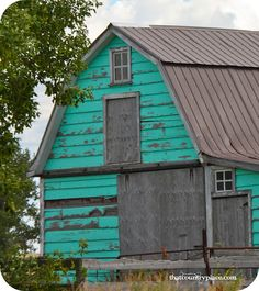 Turquoise barn with newer roof and peeling paint ~ it's a beauty   http://www.prairiegirl4-thatcountryplace.blogspot.com/