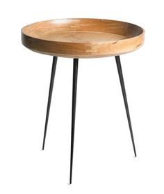 The Mater Bowl Table reconciles old Indian craftsmanship with the simplicity of Scandinavian design. The table top, made of sustainably sourced mango wood is turned on a lathe, showcasing the skill of