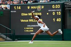 No.10 seed Venus Williams glides across the grass in the first round against Elise Mertens on No.1 Court
