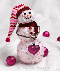 Make this sweet and cuddly snowman from chenille yarn and Styrofoam balls. AValentine's Day sock becomes the snowman's stocking cap!