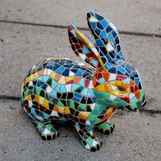 This is awesome! http://www.gardens2you.co.uk/997-2728-thickbox/mosaic-coloured-garden-rabbit-ornament.jpg