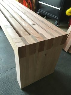 Simple redwood slat bench with modified 2x4 and 1x4s. Poorman's finger joint