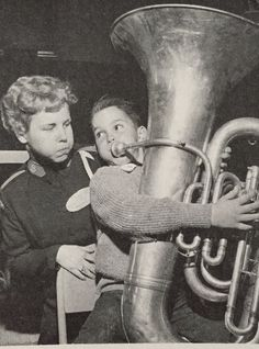 Salvation Army history- Junior soldier encouraging tuba player