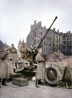 GUN-CREW OF THE SOVIET 37 MM AUTOMATIC AIR DEFENSE GUN M1939 (61-K) IS MONITORING THE AIR SITUATION IN BERLIN 1945