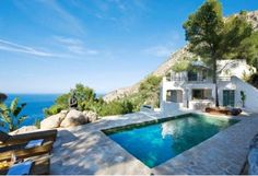 DREAM HOMES | THE STYLE FILES |  A beautiful cultural mixture: East meets West - what a nice setting next to the pool with great view - Almost to good to be true..A dream home!