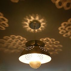 Colander Lamp, the reflections are awesome. Wow - what a good idea! I would paint the strainer though.. it is sort of ugly over the bulb..