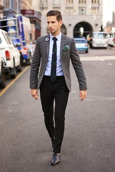 Pairing a charcoal wool sport coat and black dress pants will create a powerful and confident silhouette. Mix things up by wearing black leather brogues.   Shop this look on Lookastic: https://lookastic.com/men/looks/blazer-dress-shirt-dress-pants/17842   — Light Blue Dress Shirt  — Dark Green Polka Dot Pocket Square  — Navy and Green Plaid Tie  — Charcoal Wool Blazer  — Black Dress Pants  — Black Leather Brogues