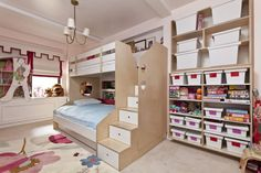 This Casa Kids design features a twin-over-full bed design that is very popular. The full-size lower bed is great or sleepovers or overnight guests. Storage stairs and a full wall of storage shelving and bins means a place for everything and everything in its place.