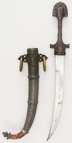 Moroccan koumaya dagger, 19th century, steel, silver, brass, wax, H. with sheath 17 1/4 in. (43.8 cm); H. without sheath 16 3/4 in. (42.5 cm); W. 2 3/8 in. (6 cm); Wt. 8.4 oz. (238.1 g); Wt. of sheath 14.9 oz. (422.4 g), Met Museum.