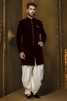 Buy Dark maroon velvet ethereal jodhpuri sherwani with full sleeves & pearl white dhoti pants Online Indian Groom Dress, Wedding Dresses Men Indian, Wedding Dress Men, Wedding Suits, Wedding Attire, Wedding Wear, Mens Indian Wear, Indian Men Fashion, Mens Fashion