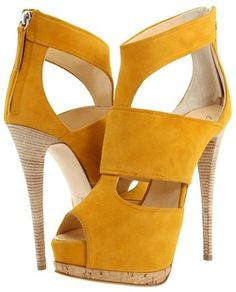 guiseppe zanotti cut-out boots (kinda) with stacked wood heels - love! #shoeporn