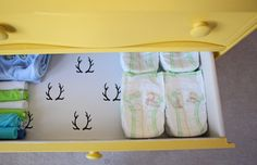 Lined drawers in dresser/changing table - love this fun surprise when you open the drawer! #nursery