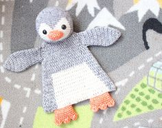 This little Penguin Ragdoll will melt anyone's heart! Even though the body is flat like a lovey, this animal will leave much more room for imagination and be a best friend to toddlers and even older children.    This is an easy pattern which works up rather fast. Level: Advanced beginner.    You'll need: -Dk weight yarn in grey (150m), white (100m) and orange (50m). I used Scheepjeswol Stone Washed. -Crochet hook 3mm or D -Black safety eyes 12mm -Small amount of fiberfill stuffing -Yarn…