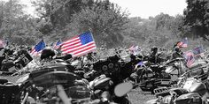 American flag among the bikes and dust of Rolling Thunder Run to the Wall memorial day rally