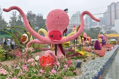 "a mosaiculture display entitled ""My Home Among the Corals"" showcasing marine creatures living in the coral reefs."