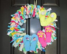 T-shirt scrap wreath- great way to use old camp shirts after they have been trimmed for quilt!
