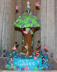 Tinkerbell Tree Cake - Cake is iced with buttercream.  Tree is made from fondant and rice krispy treats.