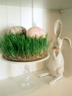 Easter wheat grass centerpiece. Glue dollar store goblet to plate. Center between old grey rabbits.