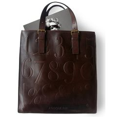 What's he wearing?: cole haan for assouline leather bag