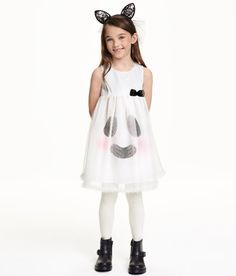 Check this out! Sleeveless dress in tulle with a glittery printed design. Opening at back of neck with button, small tulle wings at back, and attached bow at front. Printed motif on liner skirt, visible through tulle at front. - Visit hm.com to see more.