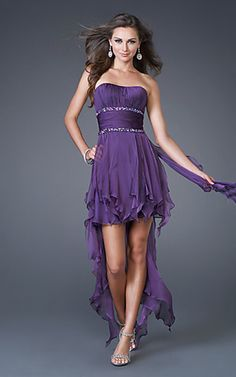 La Femme 15087 Strapless Layered Ruffles Empire Beaded High Low Corkscrew Plum Prom Dress  Looking for chic, fun, and flirty! This fabulous short strapless dress for prom is all that and more. A stunning cocktail or holiday dress featuring a ruched strapless bodice and a short skirt with layers of long ruffles cascading down the back. A strapless short dress that all your friends will want to borrow.
