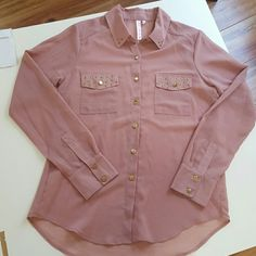 Pink chiffon button up shirt Adorable pink chiffon long sleeve shirt os light weight and has a lower cut back that covers your butt. Gold tone buttons really pop because there are gold stud detailing. Factory default in the collar shown in last picture. Not noticable when worn. Like new condition. Boutique Tops Blouses