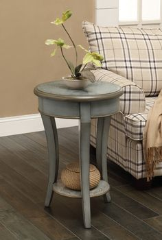 Features:  -Finish: Henley gray green.  -Hand painted floral pattern.  -Sleek tapered legs.  Shape: -Round.  Design: -Table.  Style: -Rustic.  Top Finish: -Henley Gray Green.  Base Finish: -Henley Gra