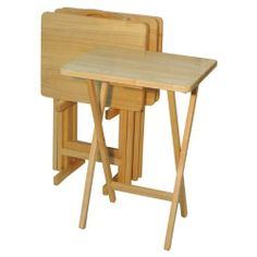 """5 Piece Tray Table Set by Brookstone. $69.00. 19 1/2"""" W x 14 1/2"""" D x 25 1/2"""" H. Beechwood with mahogany stain. Set contains: 4 tray tables, storage stand. 5 Piece Tray Table Set. These Tray Tables are sleek, modern, and convenient Made of 100-percent solid wood and easy to assemble. The set includes 4 tables and a convenient storage rack. Perfect for any room in the house when extra table space is needed. Dimensions: 26""""L x 19""""W x 14.75""""H"""