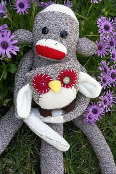 Hand made sock monkey with stitched mo and lo