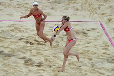 Misty May-Treanor (L) watches as Kerri Walsh Jennings