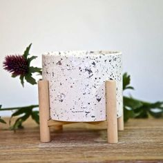 A beautiful Scandinavian style candle pot with terrazzo print set on a white background. The pot is filled with unscented candle wax and sits on a natural wooden stand, adding contemporary style to your interiors. #candle #candlepot #candleholder #candlestand #scandinavianstyle Home Interior Accessories, Decorative Accessories, Decorative Boxes, Candle Stand, Candle Wax, Glass Holders, Candle Holders, Hurricane Lanterns, Heart Wall