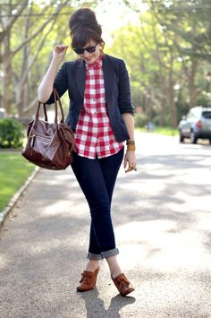 Street style outfit with a beautiful brown bag, a nice red checked top and navy blue jeans.