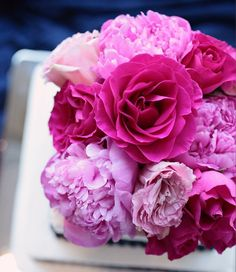 Wouldn't mind having a fresh bouquet of peonies and roses sitting on my bookcase everyday.