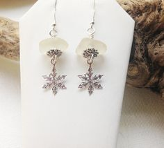 Sterling Sea Glass Earrings Beach Glass Earrings Snowflake Jewelry FREE Shipping inside the United States Beautiful frosted white beach glass, found by me on the shores of Lake Erie! Center drilled, they dangle from sterling silver ear wires, measuring two inches in length! They are embellished with sterling snowflake charms. Love Love Love and they are perfect for yourself or a beach friend! Enjoy!!! ***My Inspiration*** Nothing comes close to walking the beaches of Lake Erie! The hidd...