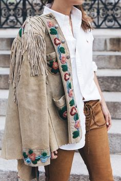 Embroidered suede jacket with fringe.