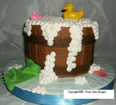 Rubba Dub Dub Baby Shower Cake: This Rubba Dub Dub Baby Shower Cake was made from 2 eight inch cakes stacked together.    The wooden barrow is made from fondant.    I rolled out the fondant,