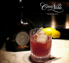 """""""Mexicali Blues"""" by Josh Wortman  1.5 oz Casa Noble Reposado 0.5 oz Art in the Age ROOT .5 oz Wild Blueberry Syrup .5 oz Fresh Lemon Juice   In a mixing glass combine 7-8 blueberries and 1/2 fresh  lemon juiced. Muddle gently and add 1.5 oz. casa Noble reposado  tequila and 1/2 oz. ROOT liqueur. Shake well and serve over fresh ice  in a rocks glass. Garnish with a lemon twist.  #Tequila #CasaNoble #Cocktails #Cocktail #DayoftheDead"""