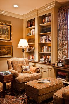 Built-ins with beautiful moldings beside the window. Eric Ross Interiors