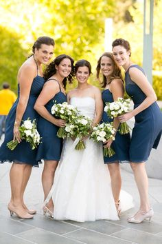 White & Greenery Bouquets, Navy Blue Bridesmaid dresses, short. Love this timeless & classic city wedding at San Francisco Ferry Building wedding venue w navy blue & gold details, white floral design & bouquets, custom welcome gifts, planned & designed by Amy Nichols Special Events, a luxury wedding planner in San Francisco, serving California, wine country, Napa, Sonoma, Hawaii, Bali, Mexico & destinations worldwide. Navy Blue Bridesmaid Dresses, Wedding Bridesmaids, Bridal Party Dresses, Wedding Dress Styles, Autumn Wedding, Green Wedding, California Wedding, California Wine, Northern California