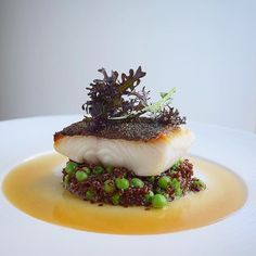 [black cod] by ・・・ Bacon dashi poached crispy skin black cod on pork stock braised red quinoa with sweet baby peas If you also want to get featured and get the opportunity to share your story about your meal at berlinerspeisemeisterei just tag your Food Design, Seafood Recipes, Gourmet Recipes, Gourmet Desserts, Gourmet Foods, Gourmet Food Plating, Sushi Recipes, Food Plating Techniques, Japanese Recipes