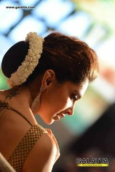 Deepika Padukone, Perfect tradditional low bun, with a neatly made gajra. Care however should be taken before adopting such hairstyles, as due to it's high static charge, it will cause phlegm to move up in the throat, causing the voice to quaver & a frequent urge to clear the throat. A heavy chabi chhalla with a long & wide hook if inserted at the edge of the pleats of the saree, will reduce this problem as it's hook will activate the acupressure points that act to keep the throat clear.