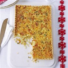 Caramelised onion tart recipe. This simple vegetarian starter is perfect for a lunch party or as part of a Boxing Day buffet.
