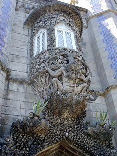 """Sintra Portugal - """"One of the most well-known and obvious details of the palace (Pena Palace) is this window with the depiction of a newt, symbolizing the allegory of creation of the world.""""       http://2.bp.blogspot.com/-zEgI1sOdqU0/TdBrgX8AM-I/AAAAAAAAAls/Ydmct9kFDko/s1600/10+Sintra+Portugal+Pena+castle+Moorish+park+flowers.jpg"""