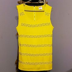 Yellow tank top Rhinestone embellishment on front, zipper detail on back, bought from a boutique and never wore, (New without tags), super cute and bright! Roman fashion Tops Tank Tops