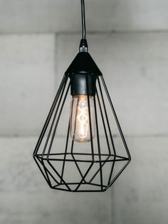 Black cage pendant light Had these in local Forsyths shop - idea for kitchen above breakfast bar